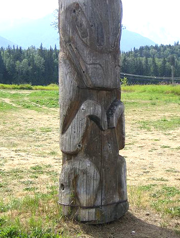Primitive totem pole as a fetish object utilized by tribal lesbians.