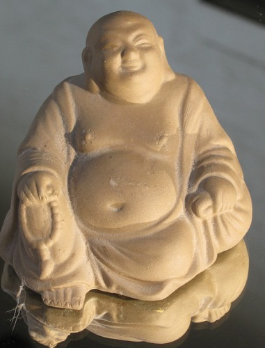 Laughing Buddha loves to have lusty hands laid upon him.